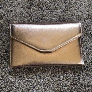 NWOT Zoffer travel wallet in metallic rose gold